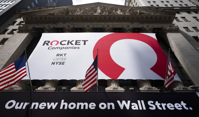 A Rocket Companies sign is displayed on the exterior of the New York Stock Exchange, Thursday, Aug. 6, 2020, in New York. Shares of Rocket Companies, parent of Quicken Loans, began trading Thursday during the Detroit company's IPO at the NYSE. Quicken is the largest retail mortgage originator in the U.S. (AP Photo/Mark Lennihan)