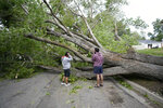 People survey the damage after high winds caused widespread damage and power outages Tuesday, Sept. 8, 2020, in Salt Lake City. (AP Photo/Rick Bowmer)