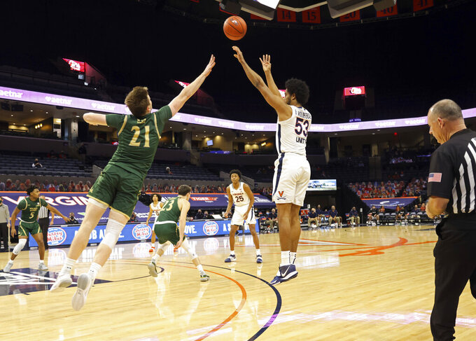 Virginia guard Tomas Woldetensae (53) shoots over William & Mary forward Quinn Blair (21) during an NCAA college basketball  game Tuesday, Dec. 22, 2020, in Charlottesville, Va. (Andrew Shurtleff/The Daily Progress via AP)