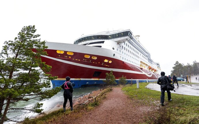 "A view of the Viking Line cruise ship Viking Grace, run aground with passengers on board, south of Mariehamn, Finland, Saturday, Nov. 21, 2020. A Baltic Sea ferry with 331 passengers and a crew of 98 has run aground in the Aland Islands archipelago between Finland and Sweden. Finnish authorities say there are ""no lives in immediate danger"" and the vessel isn't leaking. The Finnish coast guard tweeted Saturday afternoon that the Viking Line ferry that runs between the Finnish port city of Turku and Swedish capital Stockholm hit ground just off the port of Mariehamn, the capital of the Aland Islands.  (Niclas Nordlund/Lehtikuva via AP)"