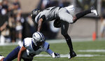 New Hampshire cornerback Isiah Perkins, left, trips up Colorado wide receiver Tony Brown after he pulled in a pass in the first half of an NCAA college football game Saturday, Sept. 15, 2018, in Boulder, Colo. (AP Photo/David Zalubowski)