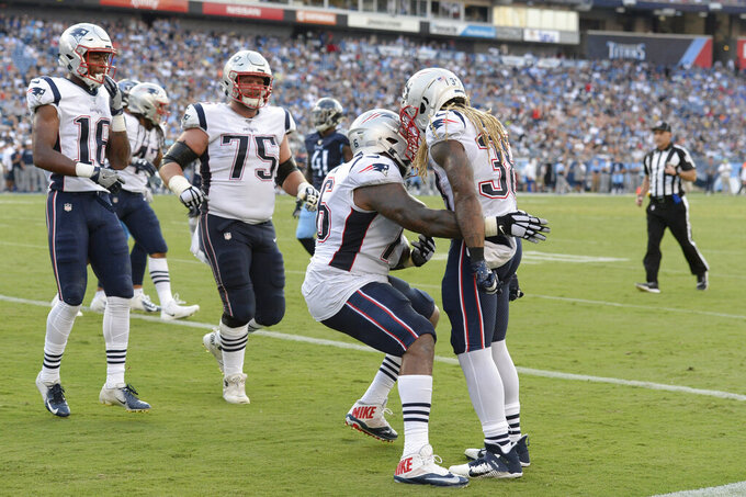 New England Patriots running back Brandon Bolden (38) is congratulated by Isaiah Wynn (76) after Bolden scored a touchdown on a 1-yard run against the Tennessee Titans in the first half of a preseason NFL football game Saturday, Aug. 17, 2019, in Nashville, Tenn. (AP Photo/Mark Zaleski)