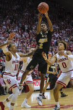 Purdue guard Eric Hunter Jr. (2) shoots between Indiana defenders Devonte Green (11) and Romeo Langford (0) during the first half of an NCAA college basketball game in Bloomington, Ind., Tuesday, Feb. 19, 2019. (AP Photo/AJ Mast)
