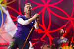 """FILE - Chris Martin of Coldplay performs at Metlife Stadium on Aug. 1, 2017, in East Rutherford, N.J.  Coldplay's latest album, """"Music of the Spheres,"""" releases Oct. 15.  (Photo by Scott Roth/Invision/AP, File)"""