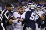 The New York Giants and Dallas Cowboys scuffle between plays during the fourth quarter of an NFL football game, Monday, Nov. 4, 2019, in East Rutherford, N.J. (AP Photo/Adam Hunger)