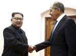 FILE - In this Thursday, May 31, 2018 file photo, Korean leader Kim Jong Un, left, and Russia's Foreign Minister Sergei Lavrov shake hands during a meeting in Pyongyang, North Korea. When Russian President Vladimir Putin and Chinese President Xi Jinping meet Tuesday and Wednesday Sept. 12, 2018, they will have plenty to talk about thanks to U.S. President Donald Trump. Both Russia and China have a direct interest in the future of North Korea since they both share a border with the secretive nuclear-armed nation, although the Russia-North Korea border is much smaller at just 17 kilometers (11 miles) long. (Valery Sharifulin/TASS News Agency Pool Photo via AP, File)