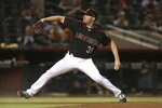 Arizona Diamondbacks starting pitcher Robbie Ray throws against the Miami Marlins during the sixth inning of a baseball game, Monday, Sept. 16, 2019, in Phoenix. (AP Photo/Ross D. Franklin)