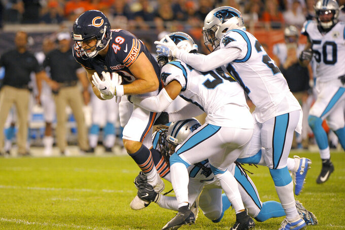 Chicago Bears tight end Ian Bunting (49) advances the ball on a pass reception from Chase Daniel during the first half of an NFL preseason football game against the Carolina Panthers on Thursday, Aug. 8, 2019, in Chicago. (AP Photo/Mark Black)