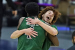 Ohio's Jason Preston, right, celebrates with Dwight Wilson III after they defeated Buffalo in an NCAA college basketball game in the championship of the Mid-American Conference tournament, Saturday, March 13, 2021, in Cleveland. (AP Photo/Tony Dejak)