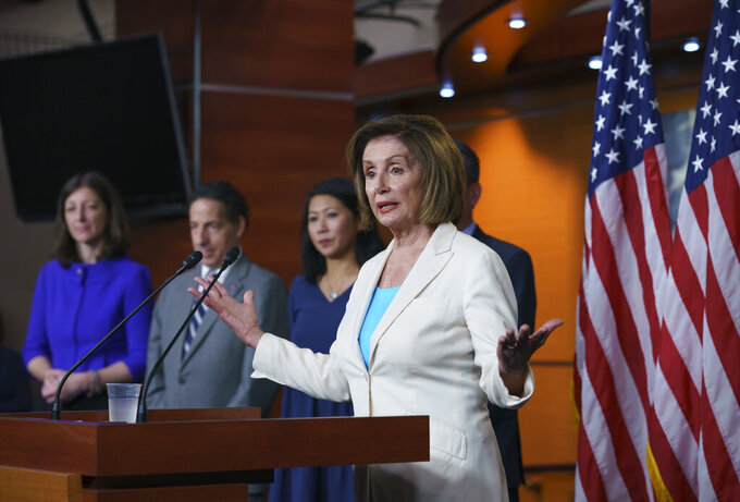 FILE - In this July 1, 2021, file photo Speaker of the House Nancy Pelosi, D-Calif., announces her appointments to a new select committee to investigate the violent Jan. 6 insurrection at the Capitol, including from left, Rep. Elaine Luria, D-Va., Rep. Jamie Raskin, D-Md., and Rep. Stephanie Murphy, D-Fla., on Capitol Hill in Washington. (AP Photo/J. Scott Applewhite, File)