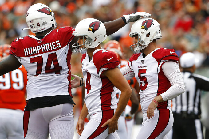 Arizona Cardinals kicker Zane Gonzalez (5) celebrates his field goal kick with offensive tackle D.J. Humphries (74) in the second half of an NFL football game against the Cincinnati Bengals, Sunday, Oct. 6, 2019, in Cincinnati. (AP Photo/Gary Landers)