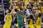 Boston Celtics' Kyrie Irving (11) has his shot blocked by Indiana Pacers' Domantas Sabonis (11) during the first half of Game 3 of an NBA basketball first-round playoff series Friday, April 19, 2019, in Indianapolis. Pacers' Thaddeus Young (21) and Wesley Matthews (23) also defend. (AP Photo/Darron Cummings)