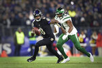 File-This Dec. 12, 2019, file photo shows Baltimore Ravens quarterback Lamar Jackson running during the first half of an NFL football game in Baltimore. No matter how many spectacular plays  Jackson and Russell Wilson made, officiating overshadowed the NFL this season. (AP Photo/Gail Burton, File)
