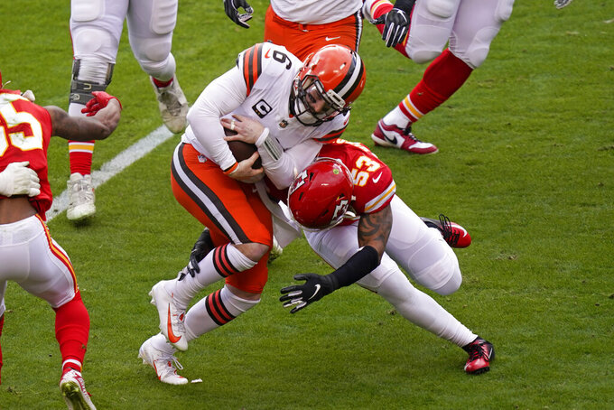 Cleveland Browns quarterback Baker Mayfield (6) is tackled by Kansas City Chiefs linebacker Anthony Hitchens (53) during the first half of an NFL divisional round football game, Sunday, Jan. 17, 2021, in Kansas City. (AP Photo/Orlin Wagner)
