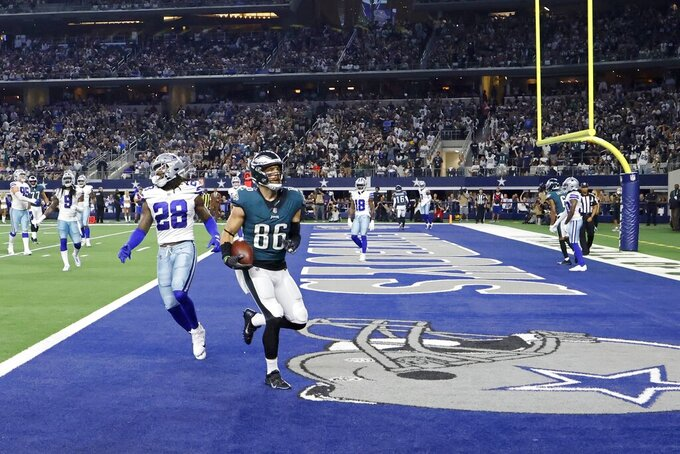 Philadelphia Eagles tight end Zach Ertz (86) makes a touchdown catch in front of Dallas Cowboys safety Malik Hooker (28) in the second half of an NFL football game in Arlington, Texas, Monday, Sept. 27, 2021. (AP Photo/Ron Jenkins)