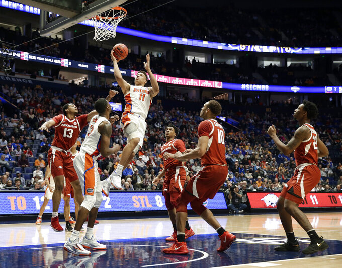 Florida forward Keyontae Johnson (11) scores against Arkansas in the second half of an NCAA college basketball game at the Southeastern Conference tournament Thursday, March 14, 2019, in Nashville, Tenn. Florida won 66-50. (AP Photo/Mark Humphrey)