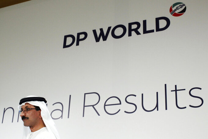 FILE - In this March 15, 2018, file photo, Sultan Ahmed bin Sulayem, DP World's chairman and CEO, walks off stage after a news conference in Dubai, United Arab Emirates. Dubai-based port operator DP World announced Thursday, March 18, 2021 its profits slid 29% in 2020 from the previous year to $846 million, as the coronavirus pandemic froze supply chains and upended the world's trade flows. (AP Photo/Jon Gambrell, File)