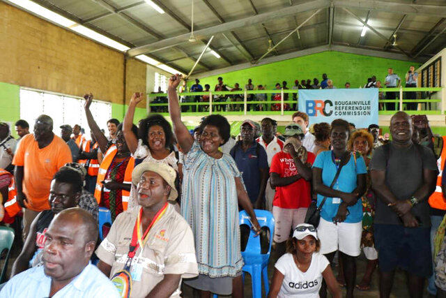In this photo provided by the U.N. in Papua New Guinea, members of the Bougainville Women's Federation cheer after results were announced in an independence referendum, Wednesday, Dec. 11, 2019, in Buka, Papua New Guinea. The South Pacific region of Bougainville voted overwhelmingly to become the world's newest nation by gaining independence from Papua New Guinea. (Serahphina Aupong/U.N. in PNG via AP)