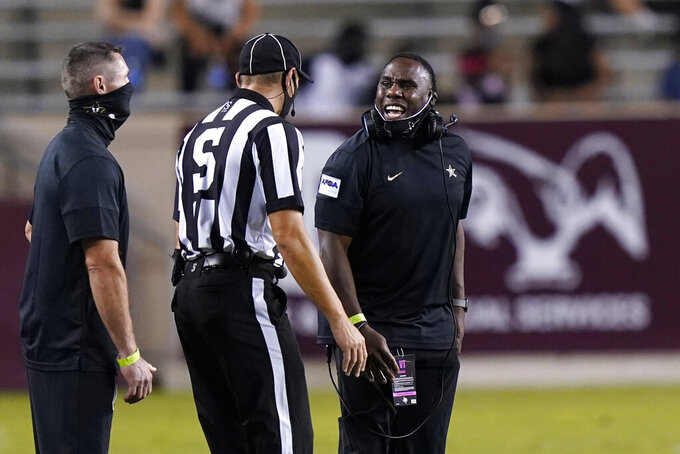 Vanderbilt coach Derek Mason, right, yells at an official during the second half of an NCAA college football game against Texas A&M Saturday, Sept. 26, 2020, in College Station, Texas. Texas A&M won 17-12. (AP Photo/David J. Phillip)