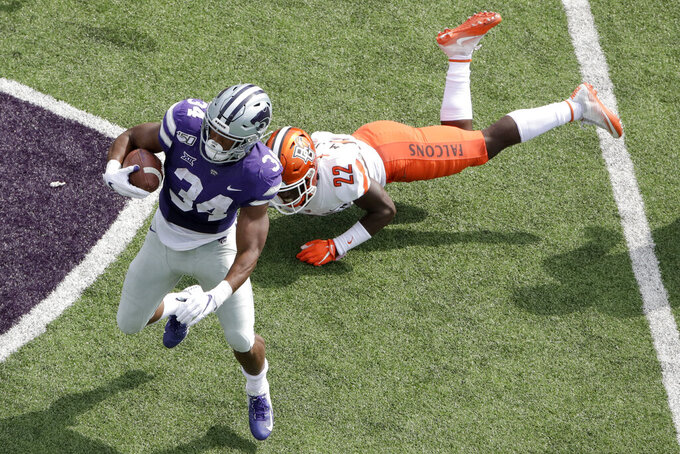 Kansas State running back James Gilbert (34) gets past Bowling Green defensive back Melvin Jackson III (22) during the first half of an NCAA college football game Saturday, Sept. 7, 2019, in Manhattan, Kan. (AP Photo/Charlie Riedel)