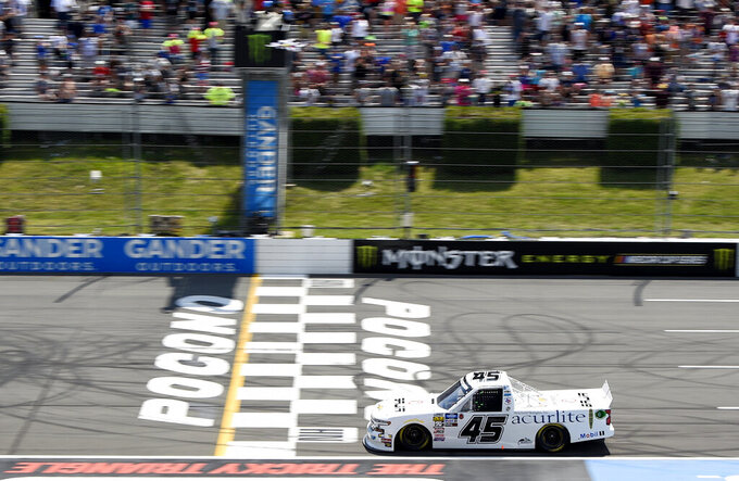 Ross Chastain crosses the finish line to win a NASCAR Truck Series auto race, Saturday, July 27, 2019, in Long Pond, Pa. (AP Photo/Derik Hamilton)