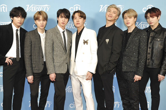 "FILE - Korean pop band BTS attends the 2019 Variety's Hitmakers Brunch in West Hollywood, Calif., on Dec. 7, 2019. The South Korean boy band BTS HAS won a leading four awards including best song for ""Dynamite"" and best group at the MTV Europe Music Awards Sunday, Nov. 8, 2020 while Lady Gaga took home the best artist prize.(Photo by Richard Shotwell/Invision/AP, File)"