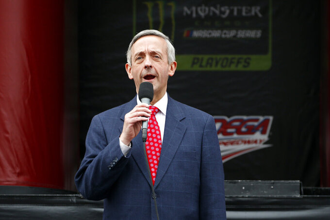 Pastor of First Baptist Church Dallas Dr. Robert Jeffress gives the invocation before a NASCAR Cup Series auto race at Talladega Superspeedway, Sunday, Oct. 13, 2019, in Talladega, Ala. (AP Photo/Butch Dill)