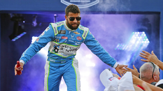Bubba Wallace greets fans during driver introductions for the NASCAR Monster Energy Cup series auto race at Richmond Raceway in Richmond, Va., Saturday, Sept. 21, 2019. (AP Photo/Steve Helber)