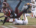Miami quarterback N'Kosi Perry (5) scores on a one yard run as Virginia Tech defender Khalil Ladler (9) falls on top of him in the end zone in the first half of an NCAA college football game in Blacksburg Va., Saturday, Nov. 17 2018. (Matt Gentry/The Roanoke Times via AP)