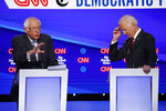 Democratic presidential candidate Sen. Bernie Sanders, I-Vt., left speaks as former Vice President Joe Biden listens during a Democratic presidential primary debate hosted by CNN/New York Times at Otterbein University, Tuesday, Oct. 15, 2019, in Westerville, Ohio. (AP Photo/John Minchillo)