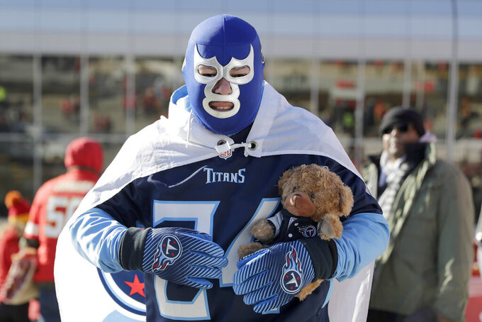 A Tennessee Titans fan arrives to Arrowhead Stadium before the NFL AFC Championship football game against the Kansas City Chiefs Sunday, Jan. 19, 2020, in Kansas City, MO. (AP Photo/Jeff Roberson)