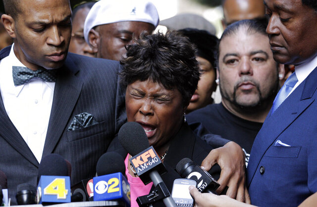 In this July 8, 2010, file photo, Wanda Johnson, center, mother of Oscar Grant, who was killed by transit officer Johannes Mehserle, speaks during a news conference in Los Angeles. As videos and stories of Black people being killed at the hands of police officers make the rounds online, many Americans have been called to protest racial injustice in recent weeks. For many Black Americans, those videos are also contributing to a sense of grief and pain. Psychologists call it racial trauma, the distress experienced because of the accumulation of racial discrimination, racial violence or institutional racism. (AP Photo/Jae C. Hong, File)