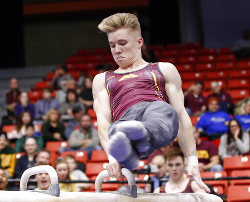 FILE - In this Jan. 18, 2020, file photo, Minnesota's Shane Wiskus competes during an NCAA gymnastics meet in Chicago. Wiskus is an Olympic hopeful who moved to the Olympic Training Center (OTC) in Colorado Springs after his college program, Minnesota, announced it would be shutting down its program. (AP Photo/Kamil Krzaczynsk, File)
