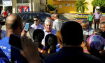 Cuba's President Miguel Diaz-Canel visits with residents after arriving in Caimanera, Cuba, Thursday, Nov. 14, 2019.  Díaz-Canel is making his first trip to the town of Caimanera, the closest point in Cuba to the U.S. naval base at Guantanamo Bay. He arrived on Thursday morning. ( AP Photo/Ismael Francisco)