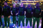 Boston Celtics wear the No. 17 during a moment of silence for former Celtic John Havlicek, who died last week, before Game 3 of the team's second-round NBA basketball playoff series against the Milwaukee Bucks in Boston, Friday, May 3, 2019. (AP Photo/Michael Dwyer)