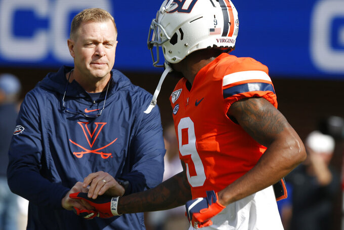 Virginia head coach Bronco Mendenhall shakes the hand of Virginia wide receiver Terrell Chatman (9) before an NCAA college football game against Duke in Charlottesville, Va., Saturday, Oct. 19, 2019. (AP Photo/Steve Helber)