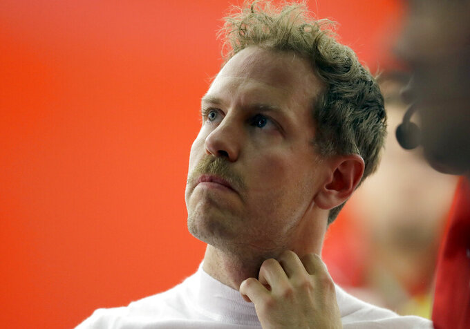 Ferrari driver Sebastian Vettel of Germany looks at his results after the second free practice at the Formula One Bahrain International Circuit in Sakhir, Bahrain, Friday, March 29, 2019. The Bahrain Formula One Grand Prix will take place on Sunday. (AP Photo/Luca Bruno)