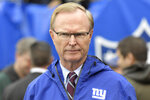 FILE - New York Giants owner John Mara walks on the field prior to an NFL football game against the Chicago Bears, Sunday, Dec. 2, 2018, in East Rutherford, N.J. A long-time advocate of the right to protest for social change and equality, New York Giants co-owner John Mara admits he was stunned listening to his players talk about their experiences with police and authorities in the wake of the death George Floyd in June.(AP Photo/Bill Kostroun, File)