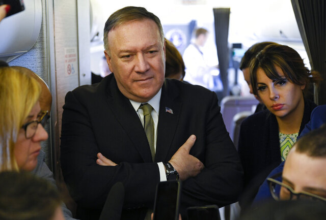 "Secretary of State Mike Pompeo takes questions from reporters during a flight from Andrews Air Force Base, Md., to Germany, Thursday, February 13, 2020. Pompeo on Thursday said he is ""outraged"" by the U.N.'s publication of a list of companies accused of violating Palestinian human rights by operating in Israel's West Bank settlements. (Andrew Caballero-Reynolds/Pool via AP)"