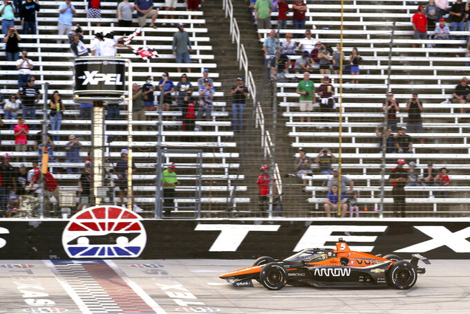 Pato O'Ward celebrates his victory at an IndyCar Series auto race at Texas Motor Speedway on Sunday, May 2, 2021, in Fort Worth, Texas. (AP Photo/Richard W. Rodriguez)