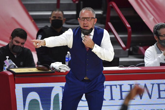 Texas A&M coach Buzz Williams talks to his team from the sideline as they play against Arkansas during the first half of an NCAA college basketball game in Fayetteville, Ark., Saturday, March 6, 2021. (AP Photo/Michael Woods)
