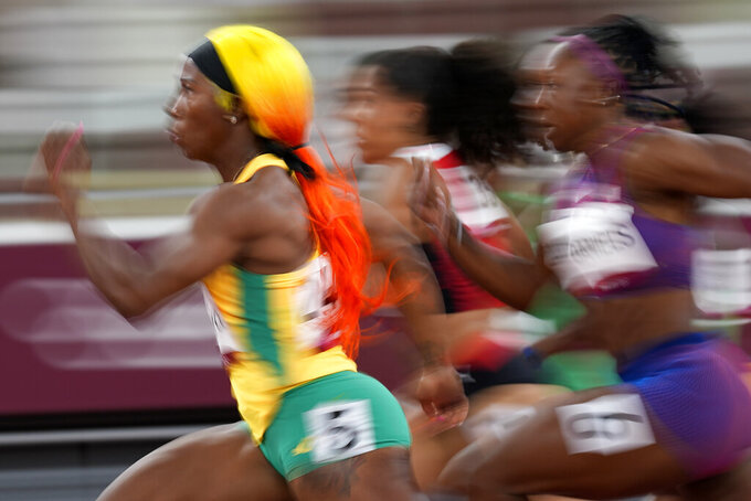 Shelly-Ann Fraser-Pryce, of Jamaica, runs in a semifinal of the women's 100-meters at the 2020 Summer Olympics, Saturday, July 31, 2021, in Tokyo. (AP Photo/David J. Phillip)