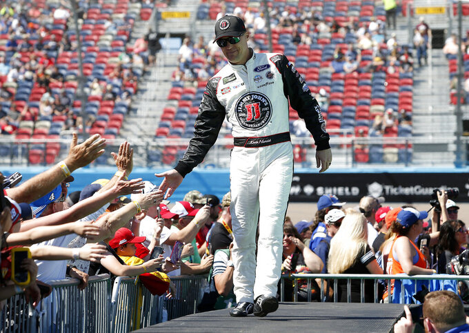 Kevin Harvick is greeted by fans during driver introductions prior to the start of the NASCAR Cup Series auto race at ISM Raceway, Sunday, March 10, 2019, in Avondale, Ariz. (AP Photo/Ralph Freso)