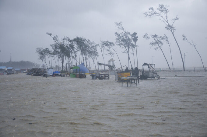 beach vendors' kiosks are surrounded by water during high tide at the Digha beach on the Bay of Bengal coast as Cyclone Yaas intensifies in West Bengal state, India, Wednesday, May 26, 2021. Heavy rain and a high tide lashed parts of India's eastern coast as the cyclone pushed ashore Wednesday in an area where more than 1.1 million people have evacuated amid a devastating coronavirus surge. (AP Photo/Ashim Paul)