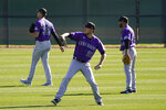 Colorado Rockies starting pitcher Kyle Freeland, center, throws during the team's spring training baseball workout in Scottsdale, Ariz., Wednesday, Feb. 24, 2021. (AP Photo/Jae C. Hong)
