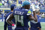 Seattle Seahawks wide receiver DK Metcalf stands on the sideline during the second half of an NFL football game against the Tennessee Titans, Sunday, Sept. 19, 2021, in Seattle. The Titans won 33-30 in overtime. (AP Photo/Elaine Thompson)