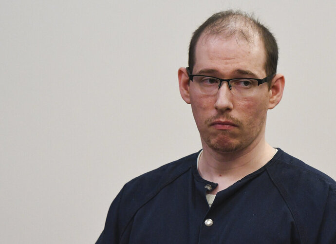 Michael Phinn, 33, appears in court in Lansing, Mich., Wednesday, Sept. 18, 2019.  The former Michigan State University medical resident who authorities say sexually assaulted two women at a university health center and forced them to watch videos of him masturbating has been sentenced to 5 to 15 years in prison. (Matthew Dae Smith/Lansing State Journal via AP)
