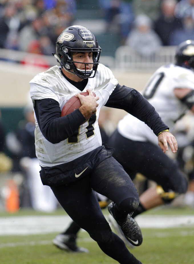 FILE - In this Saturday, Oct. 27, 2018, file photo, Purdue quarterback David Blough scrambles against Michigan State during the second quarter of an NCAA college football game, in East Lansing, Mich. The senior has locked himself in as the starter for the Boilermakers after being unable to hold onto the job last season because of poor decisions and then dislocating his ankle in November. (AP Photo/Al Goldis, File)