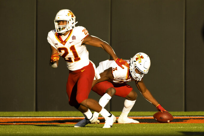 Iowa State kick return team member Jirehl Brock (21) runs downfield as Iowa State kick return Kene Nwangwu (3) recovers a dropped ball during the second half of an NCAA college football game Saturday, Oct. 24, 2020, in Stillwater, Okla. (AP Photo/Brody Schmidt)