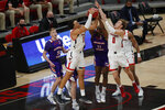 Texas Tech forward Marcus Santos-Silva and guard Mac McClung and Northwestern State forward Jamaure Gregg vie for a rebound during the first half of an NCAA college basketball game Wednesday Nov. 25, 2020, in Lubbock, Texas. (AP Photo/Mark Rogers)